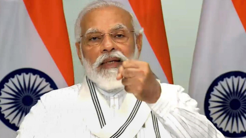 मास्क न पहनने के कारण किस प्रधानमंत्री पर जुर्माना लगा था, जिनका मोदी ने किया जिक्र?