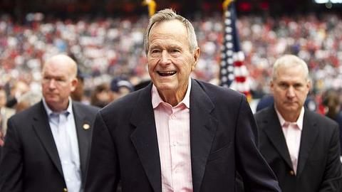 Ex-US President George Bush Sr. apologizes for patting women's rears