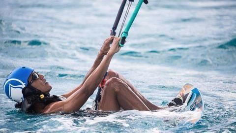 Recently retired Obama takes Caribbean vacation, learns kite-surfing