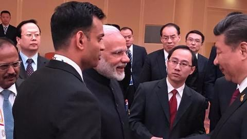 Modi and Xi shake hands amid tensed relations