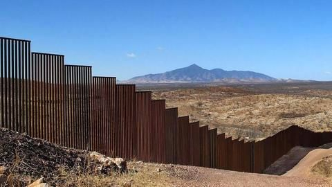 """Trump says border wall to have """"openings,"""" scales back length"""