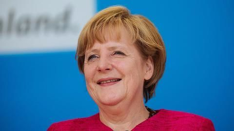 Merkel wins key state election, paves way for national polls