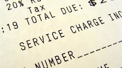Restaurants giving up levying service charge slowly