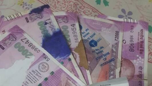 What to do with soiled Rs. 200/2,000 notes