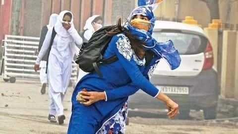 The iconic Kashmiri stone-pelter in a blue salwar