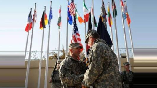 Why is NATO deploying additional troops to Afghanistan?