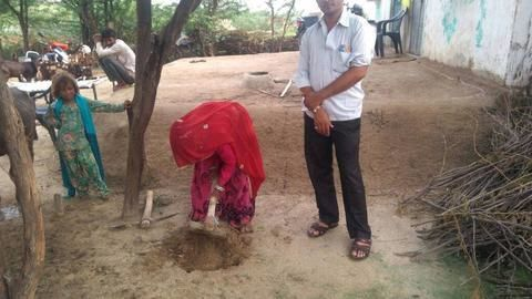 Why are Tikamgarh's school teachers digging toilet holes