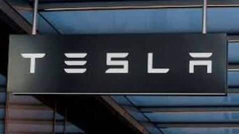 Tesla cuts 9 percent of workforce in bid to post profit