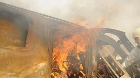 Bengaluru: Woman, son charred to death in car