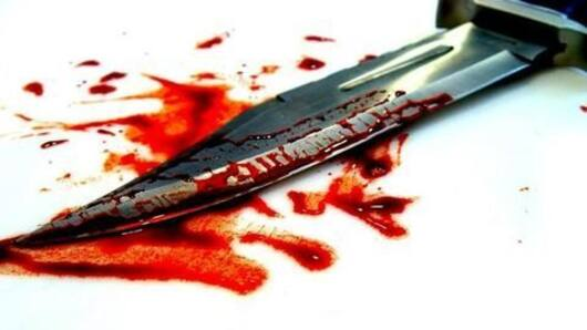 Principal hacked to death in front of students