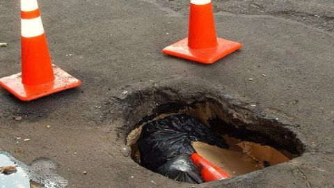 Delhi motorcyclist dies after being trapped in pothole