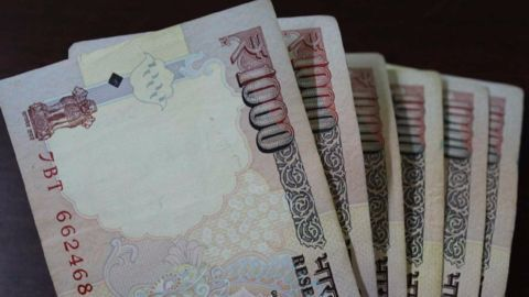 Indian rupee falls on devaluation reports
