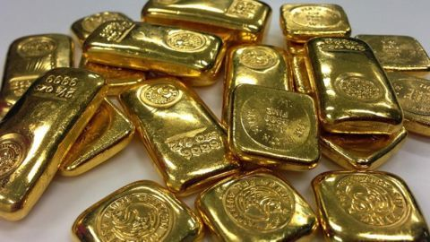 Woman carrying gold inside shorts held at IGI