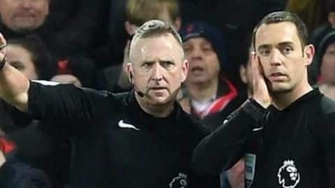 English football: Now red and yellow cards for managers too
